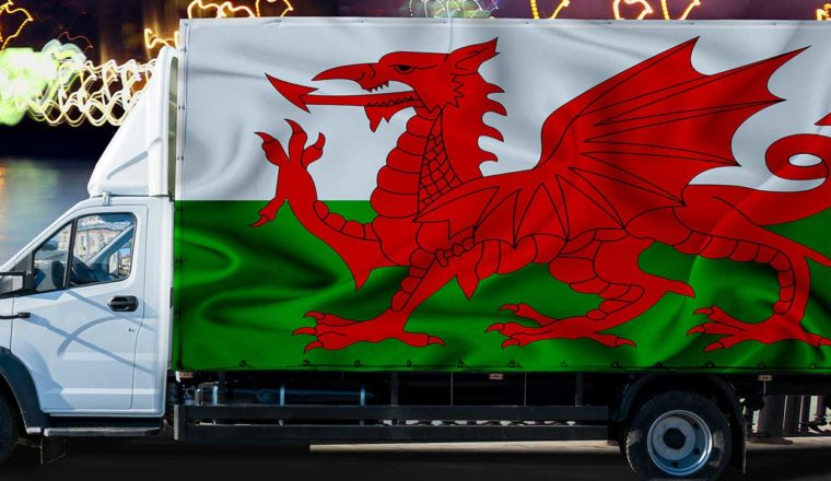 Truck with a Welsh flag on the side