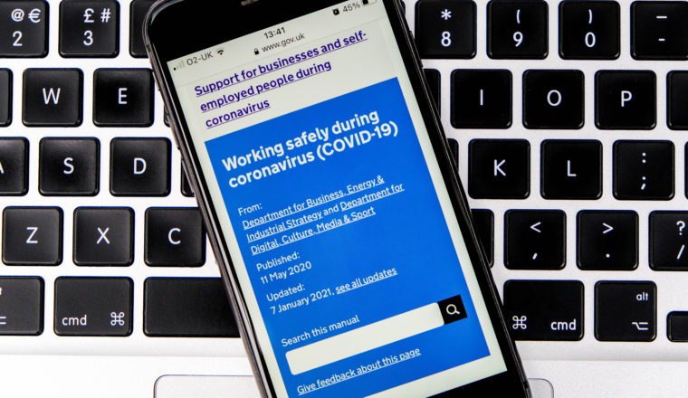 Mobile phone displaying government Covid support website
