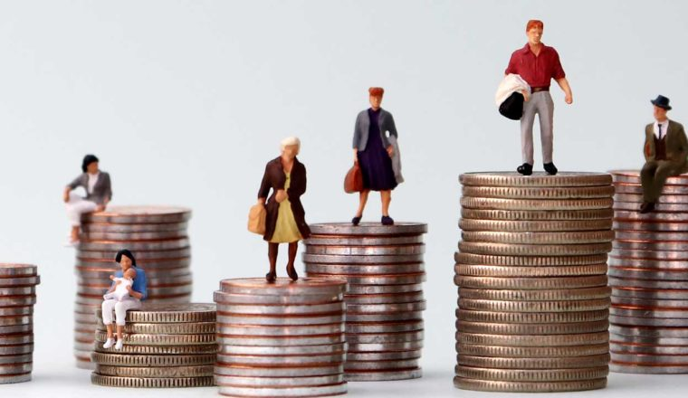 Figures standing on different piles of money